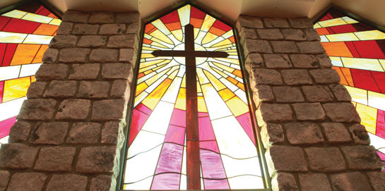 Stained glass windows in Simpson University's prayer chapel
