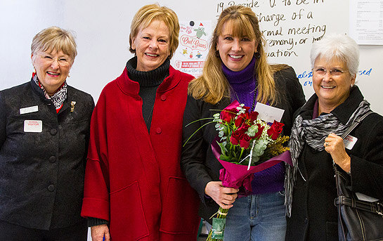 Shasta High School teacher and Simpson University alumna Leslie Ellingson holds roses given to her by, from left, Dr. Glee Brooks, Dr. Neita Novo, and Kathy Sublett