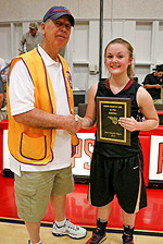 Lions Club member Mike Robinson gives MVP award to Aubrey Mendonca of West Valley High School