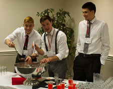 Members of the Red Hawks basketball team helped serve punch. Student volunteers helped with setup, check-in and serving