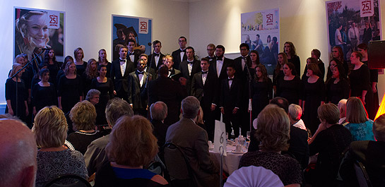 The Simpson University Chorale, under the direction of Dr. Cyril Myers and accompanied by Lois Nichols, performs two songs at the Community Appreciation Banquet