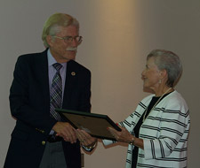 Dr. Betty Dean thanks Maurice Johannessen for his efforts to bring Simpson to Redding