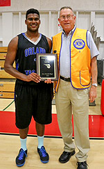 Archer Pugh of the Lions Club gives MVP award to All-Star Kavi Ram of Orland High School