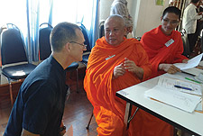 Simpson University professor Stephen Bailey meets with a Buddhist monk in Laos