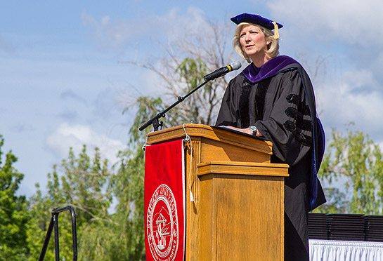 Dr. Shirley Hoogstra, president of the Council for Christian Colleges and Universities, addresses graduates during Simpson University's April 25, 2015, commencement
