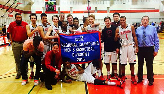 The Simpson University men's basketball team holds up the NCCAA DI West Regional championship banner