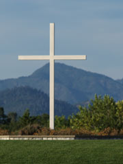 A photo of the white cross located on Simpson University's Redding campus